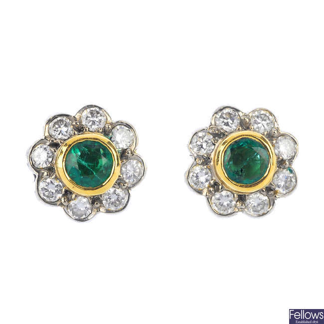 A pair of 18ct gold emerald and diamond floral cluster ear studs.