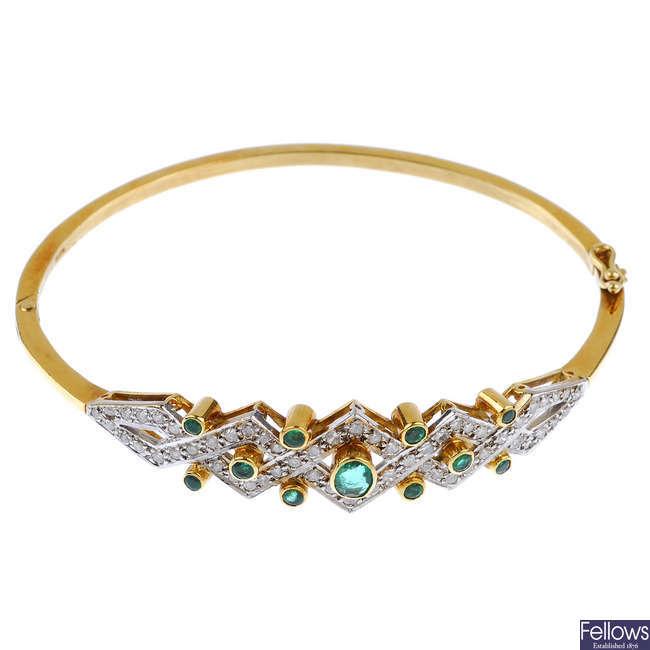 An 18ct gold emerald and diamond hinged bangle.