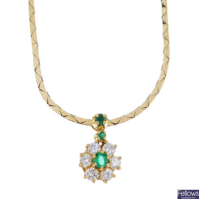 An 18ct gold emerald and diamond necklace.