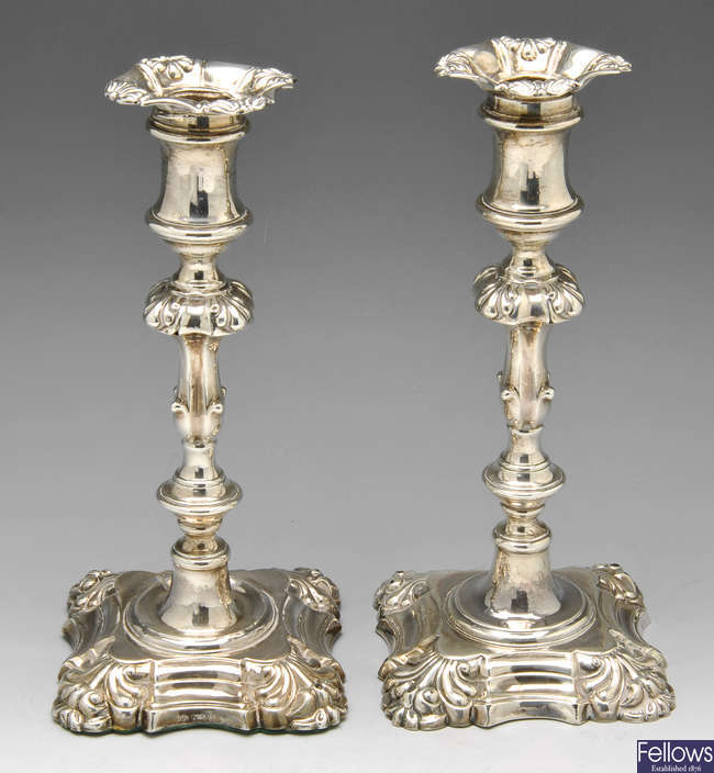 A pair of William IV silver candlesticks.