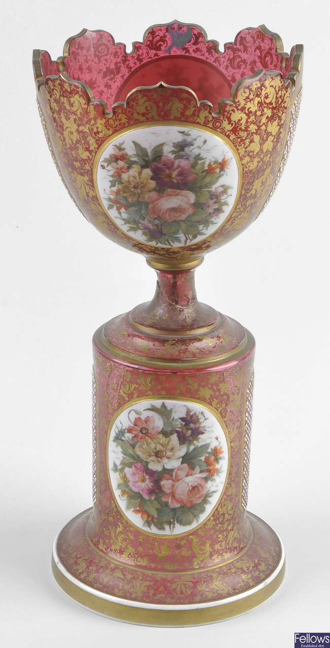 A large late 19th century Bohemian overlay cranberry glass pedestal centerpiece