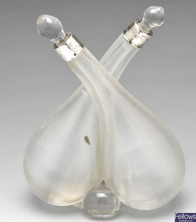 An Edwardian ribbed glass combination oil and vinegar bottle.