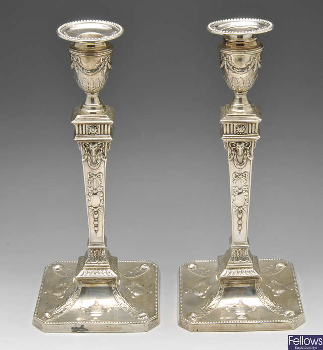 A pair of late Victorian Neoclassical revival silver candlesticks.