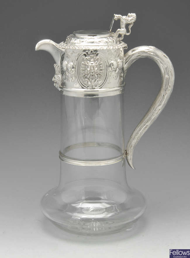 A Victorian silver mounted claret jug.