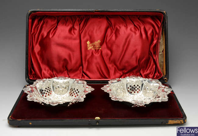 A cased pair of late Victorian silver bonbon dishes.