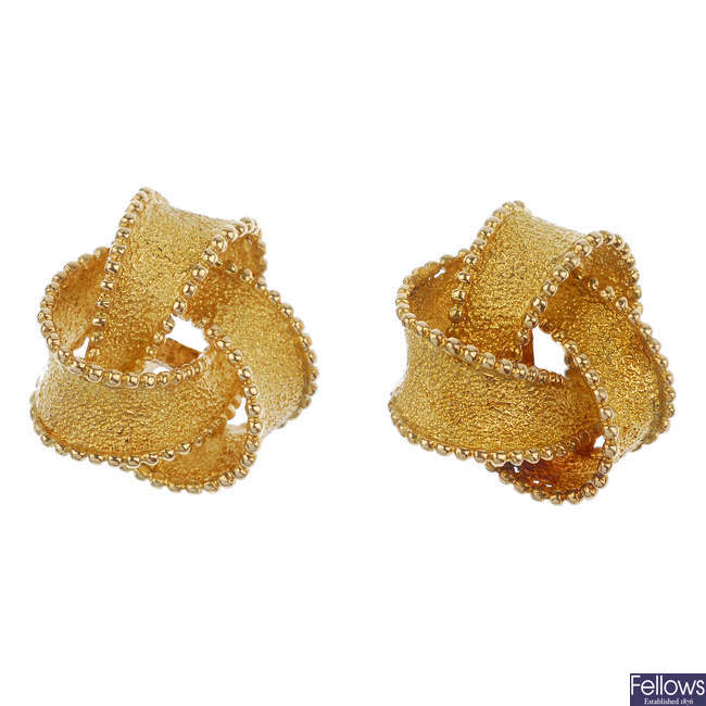 A pair of 18ct gold knot earrings.