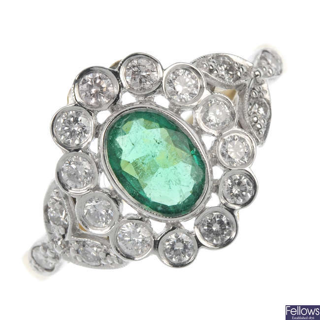 An emerald and diamond foliate cluster ring.