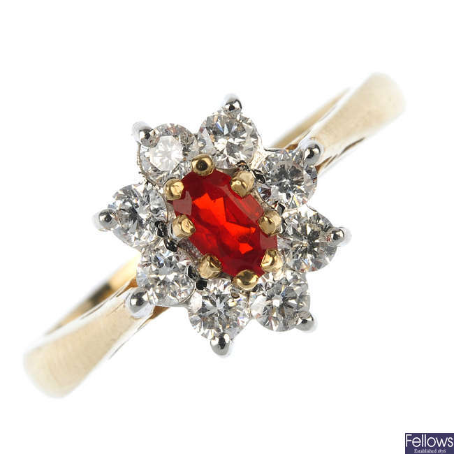 A 9ct gold fire opal and diamond cluster ring.