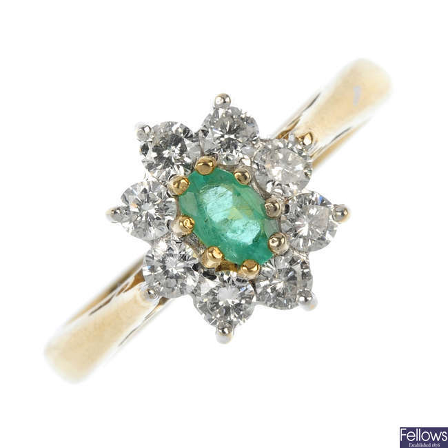 A 9ct gold emerald and diamond cluster ring.