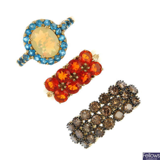 A selection of three 9ct gold gem-set dress rings.