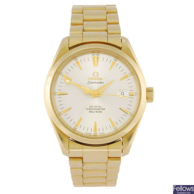 OMEGA - a gentleman's 18ct gold Seamaster Aqua Terra Co-Axial bracelet watch.