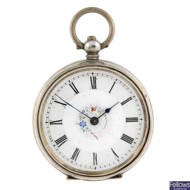 A white metal open face pocket watch together with two other similar examples.