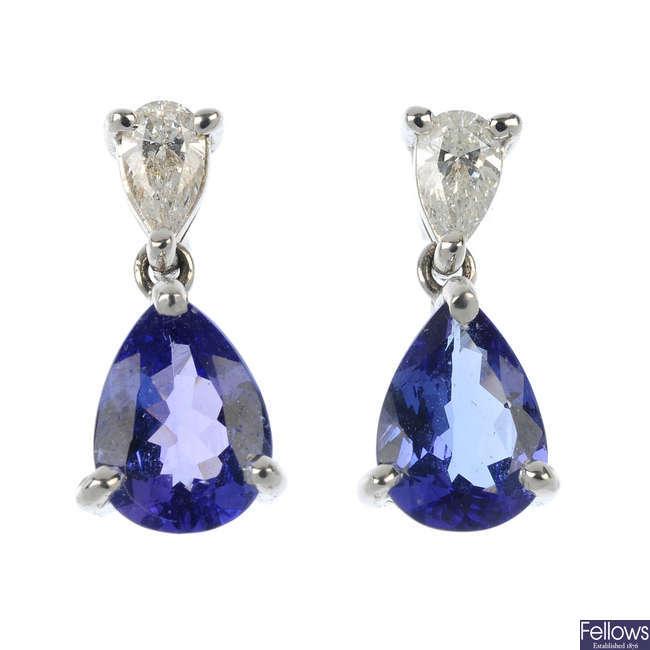 A pair of tanzanite and diamond ear pendants.