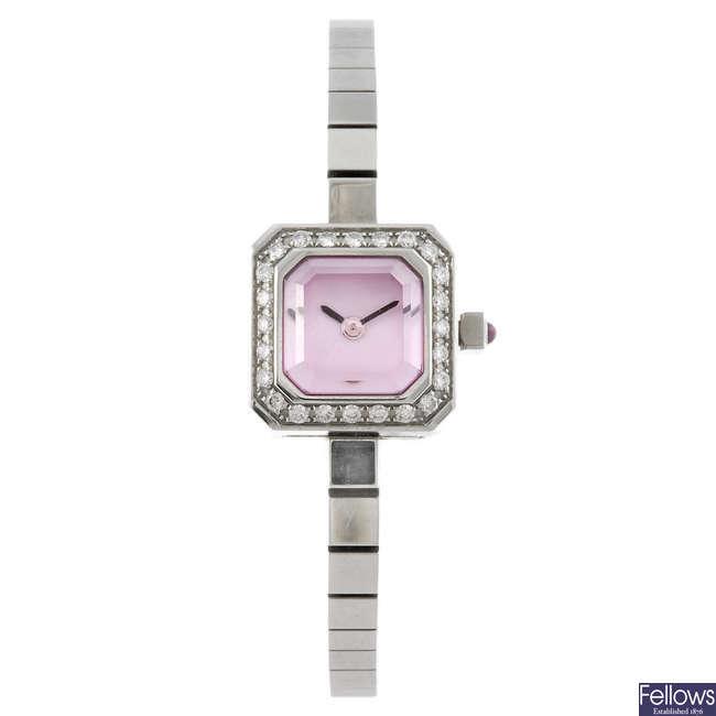 CORUM - a lady's Sugar Cube bracelet watch.