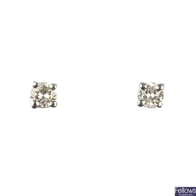 A pair of brilliant-cut diamond single-stone ear studs.