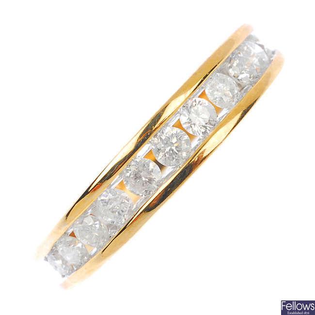 A 9ct gold diamond half-circle eternity ring.