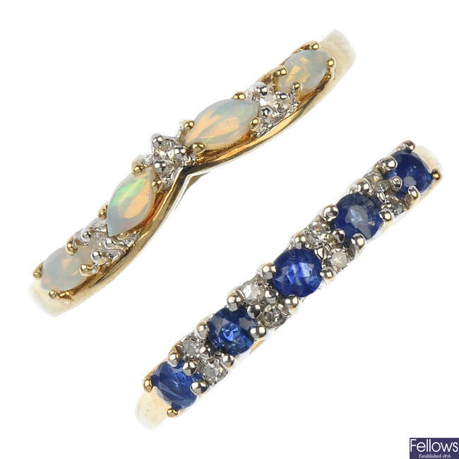 A selection of four 9ct gold diamond and gem-set half-circle eternity rings.
