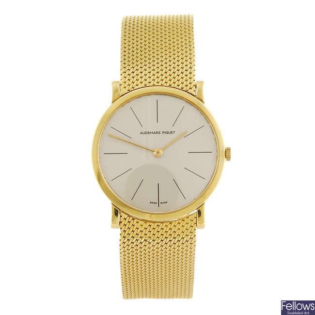 AUDEMARS PIGUET - a gentleman's 18ct yellow gold bracelet watch.