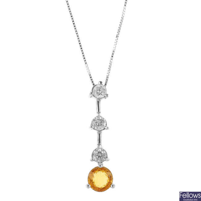 A sapphire and diamond pendant with platinum chain.