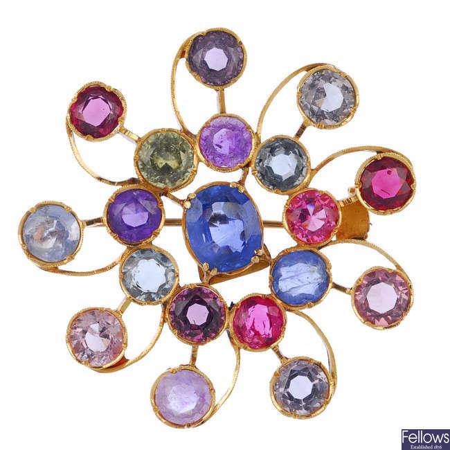 A multi-gem brooch.
