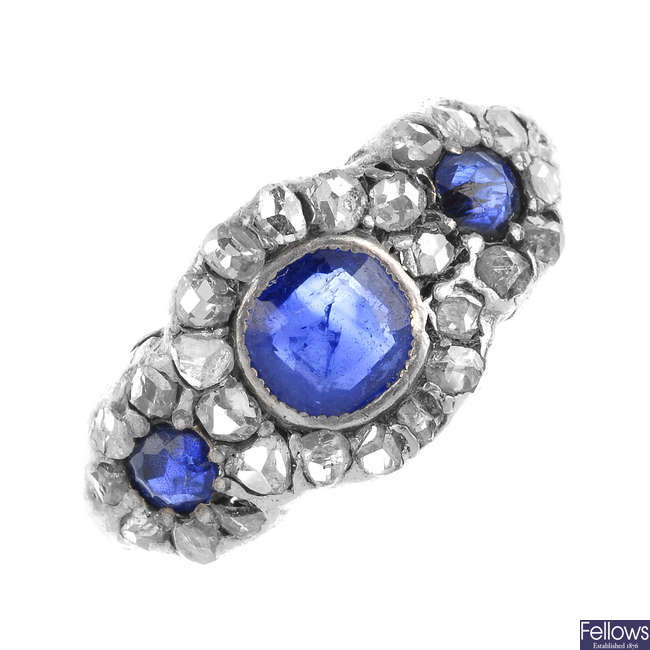 A sapphire and diamond triple cluster ring.