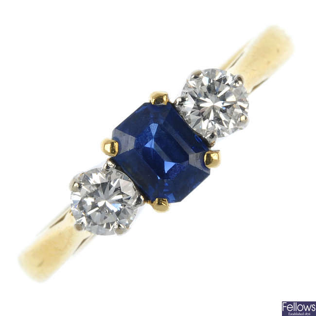 An 18ct gold sapphire and diamond three-stone ring, by Cropp & Farr.