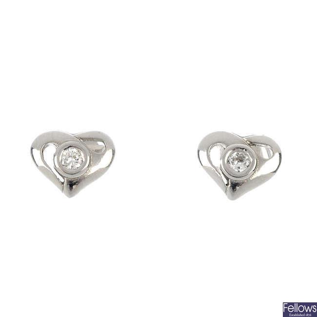 A pair of platinum diamond heart ear studs.