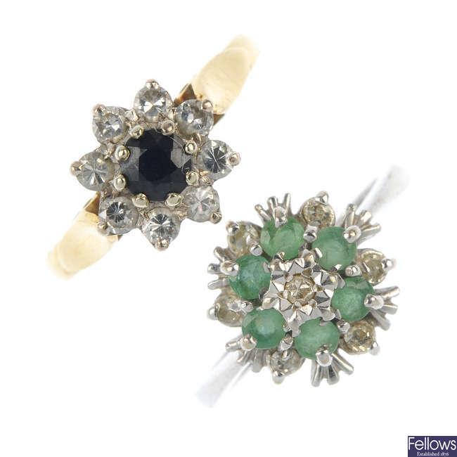 Two gold gem-set cluster rings.