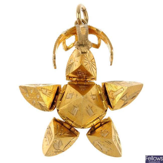 A Masonic sphere pendant.
