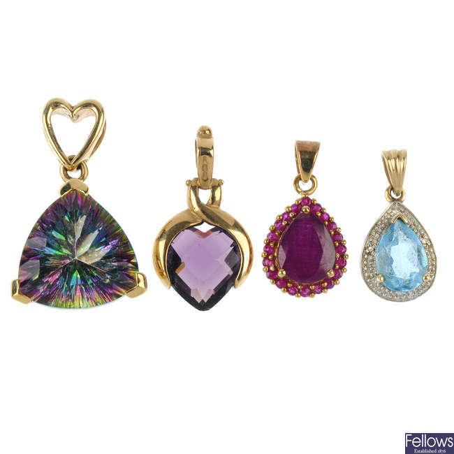 A selection of nine gem-set pendants.