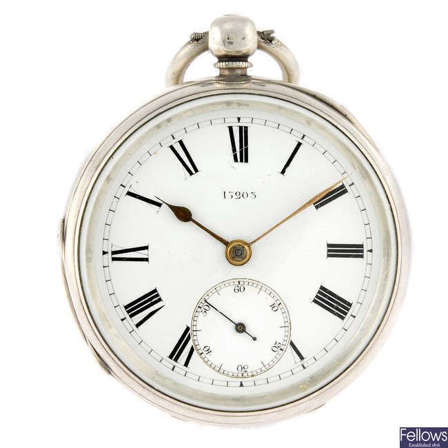 A silver open face pocket watch together with a silver Albert chain and a silver shield fob.