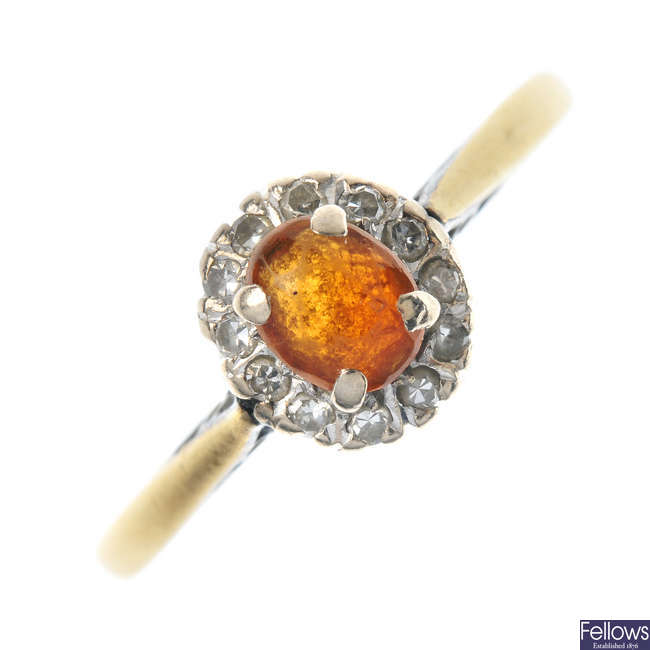 A citrine and diamond cluster ring.