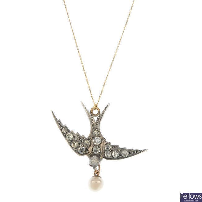 An early 20th century silver gilt paste swallow pendant.