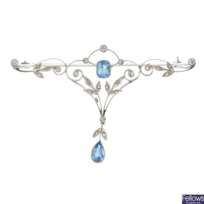 An aquamarine and diamond brooch.