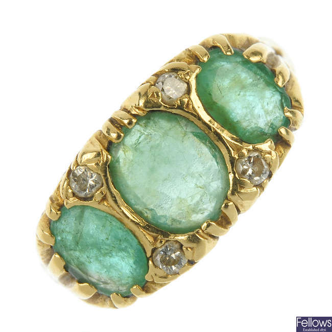 An 18ct gold emerald and diamond ring.