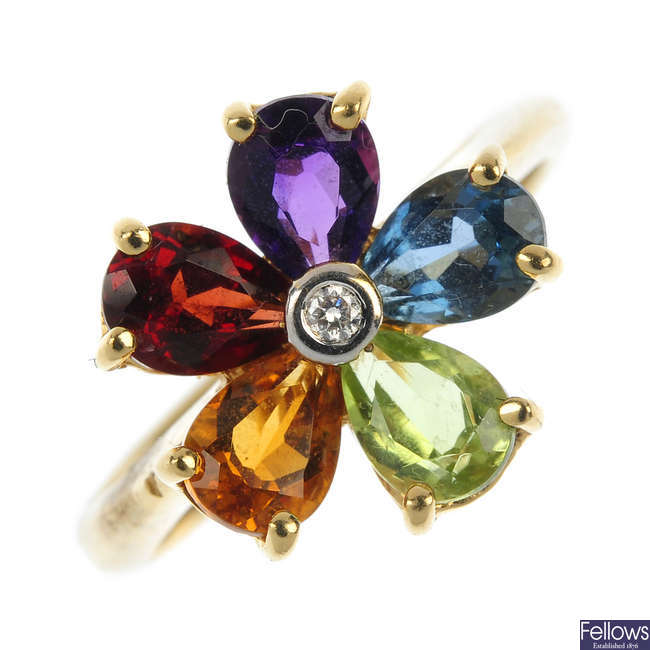 A multi-gem and diamond floral cluster ring.