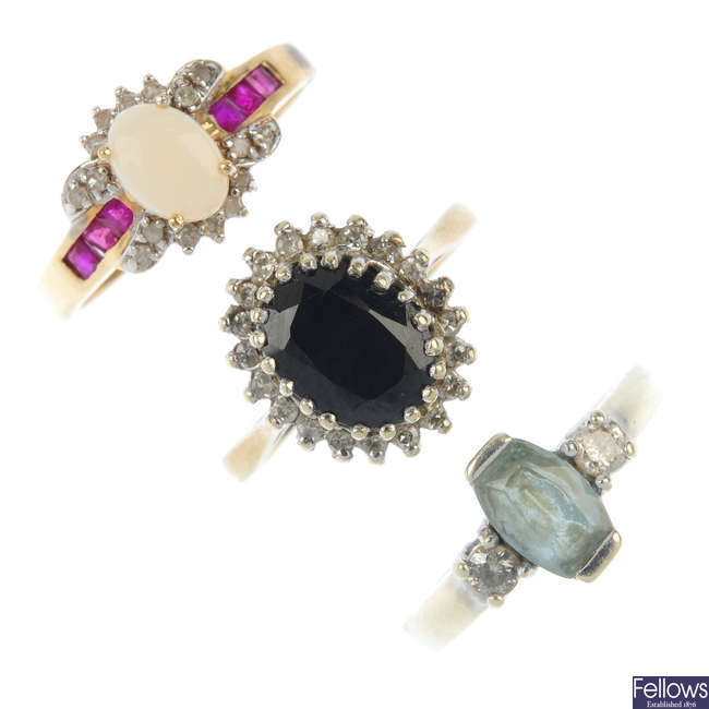 A selection of three gem-set rings.