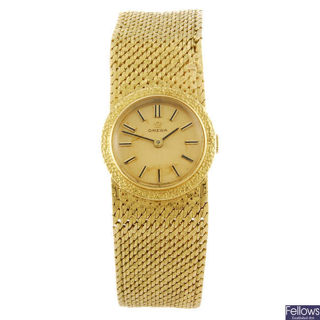 OMEGA - a lady's 18ct yellow gold bracelet watch.