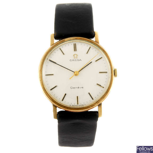 OMEGA - a gentleman's 9ct gold Geneve wrist watch with another Omega watch.