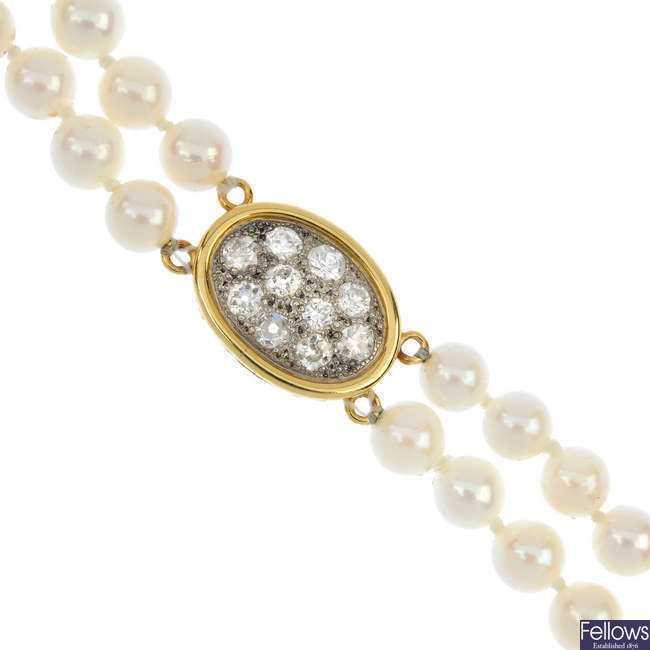 A diamond and cultured pearl two-row necklace.