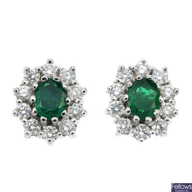 A pair of 9ct gold emerald and diamond cluster ear studs.