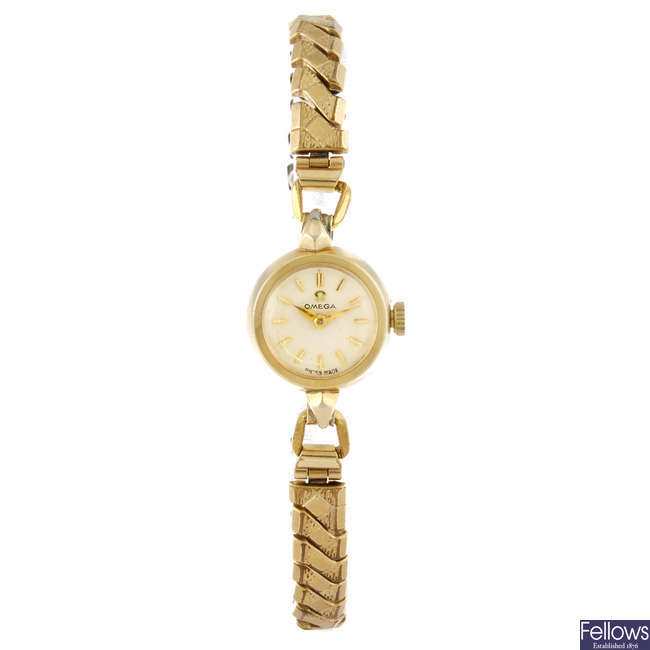OMEGA - a lady's gold plated bracelet watch.
