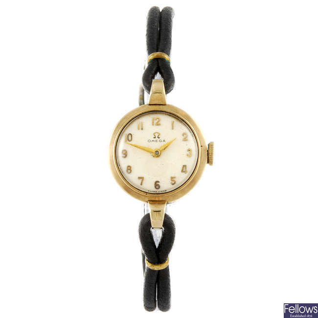 OMEGA - a 9ct gold lady's wrist watch.