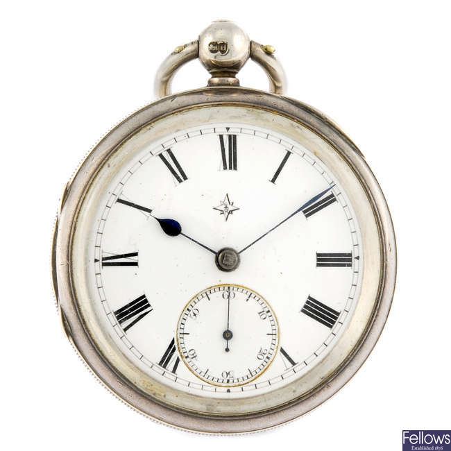 A silver open face pocket watch with two other pocket watches.