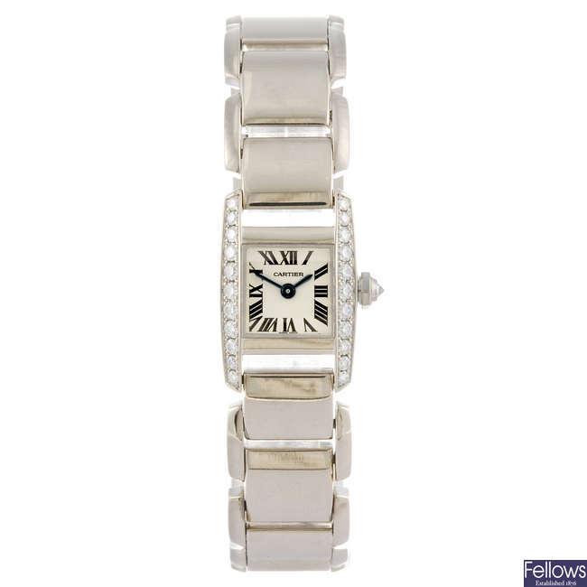 (121088290) CARTIER - a gold Tank bracelet watch.