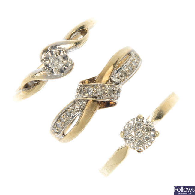 A selection of four 9ct gold diamond rings.