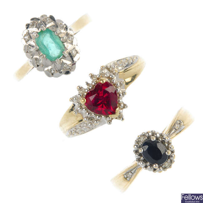 A selection of three 9ct gold gem-set cluster rings.