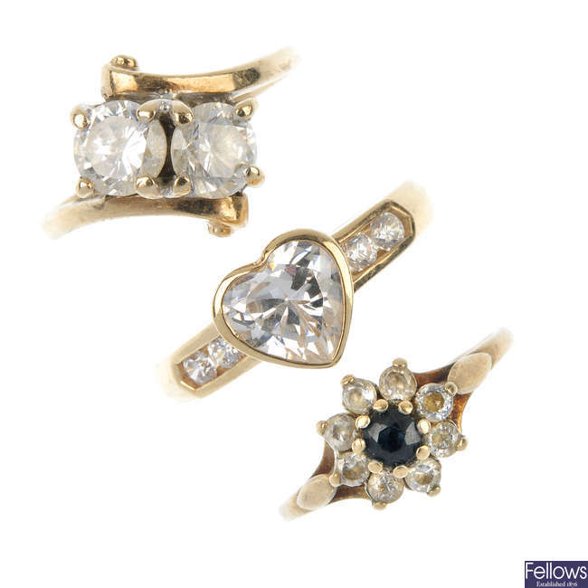 A selection of four 9ct gold cubic zirconia dress rings.