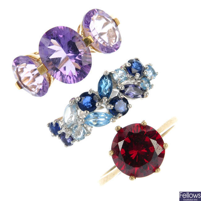 A selection of four 9ct gold cubic zirconia and gem-set dress rings.