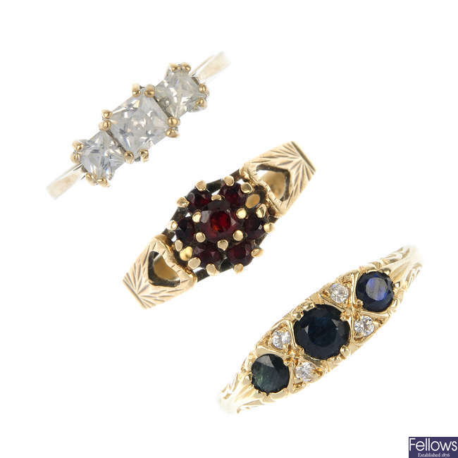 A selection of five 9ct gold gem-set rings.